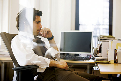 Hispanic businessman in his office